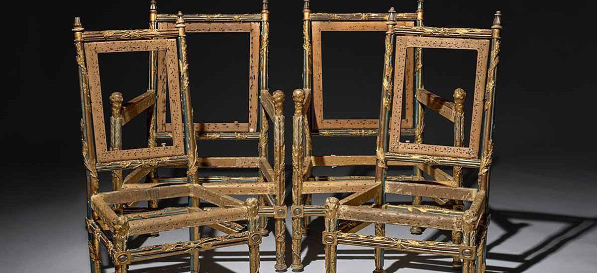 4 broken wooden chairs